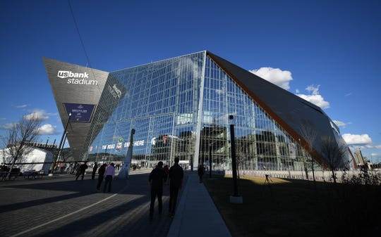 Fans arrive before the national championship game of the 2019 NCAA tournament between Virginia and Texas Tech at U.S. Bank Stadium.
