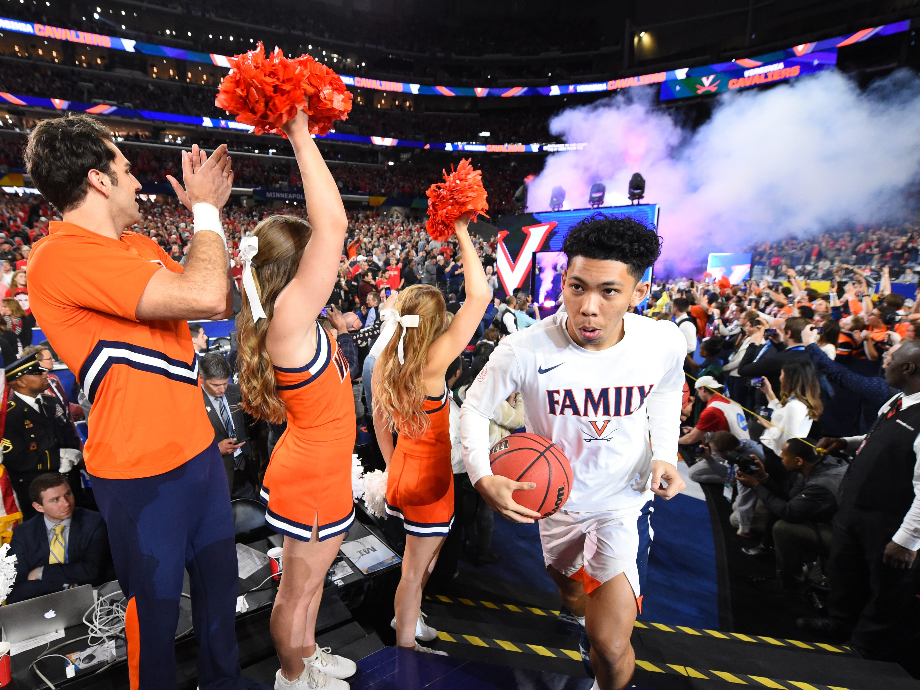 Virginia's Kihei Clark and the Cavaliers take the floor prior to face Texas Tech in the championship game.