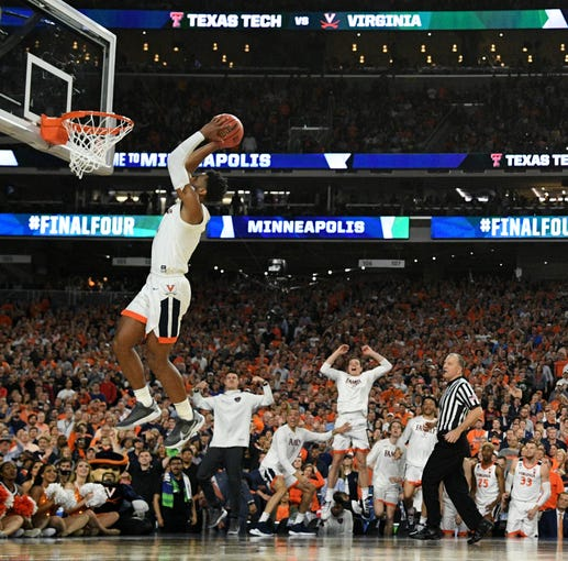 Championship: Virginia's Braxton Key (2) dunks the ball against Texas Tech in overtime. Virginia won the game, 85-77.
