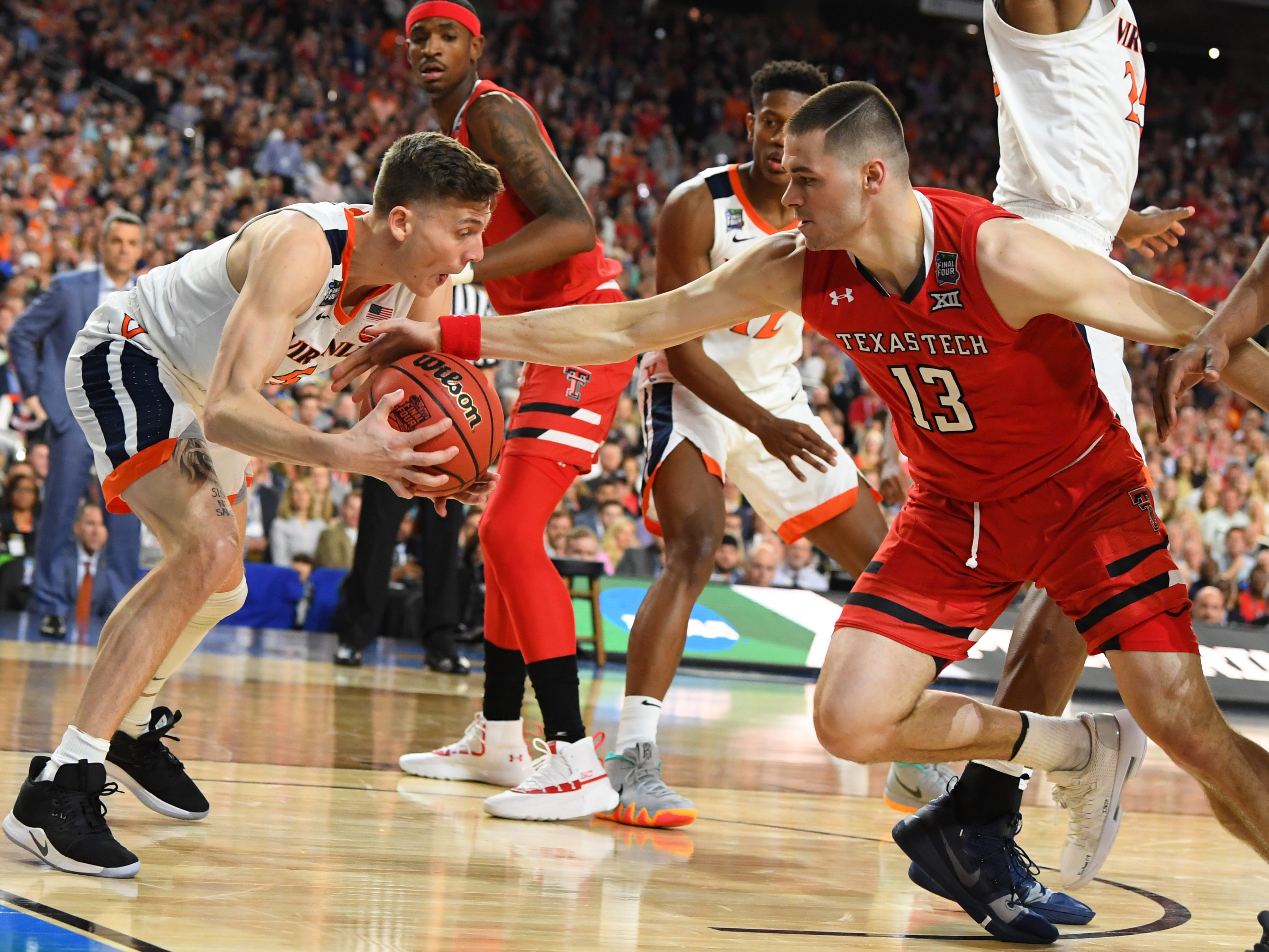 Virginia's Kyle Guy steals the ball from Texas Tech's Matt Mooney (13) in the championship game.