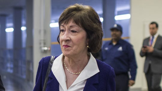 Sen. Susan Collins, R-Maine, walks through the Senate basement before a weekly policy luncheon on April 2, 2019 in Washington.