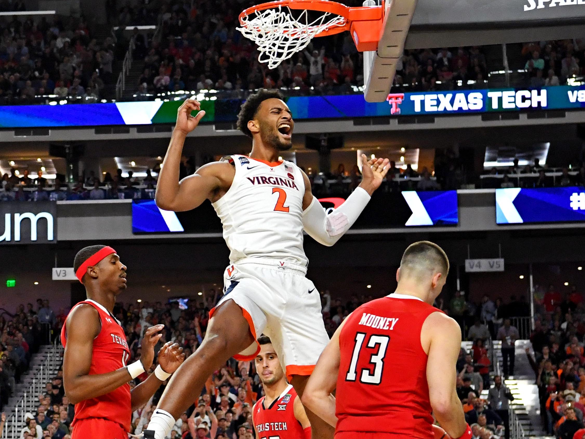 Virginia's Braxton Key dunks the ball against Texas Tech during the first half in the championship game.