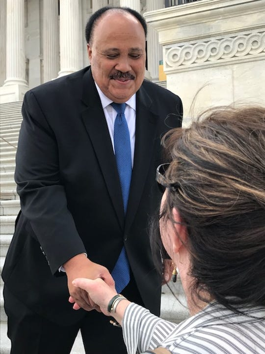 Martin Luther King III greets a spectator outside the U.S. Capitol, April 9, 2019.