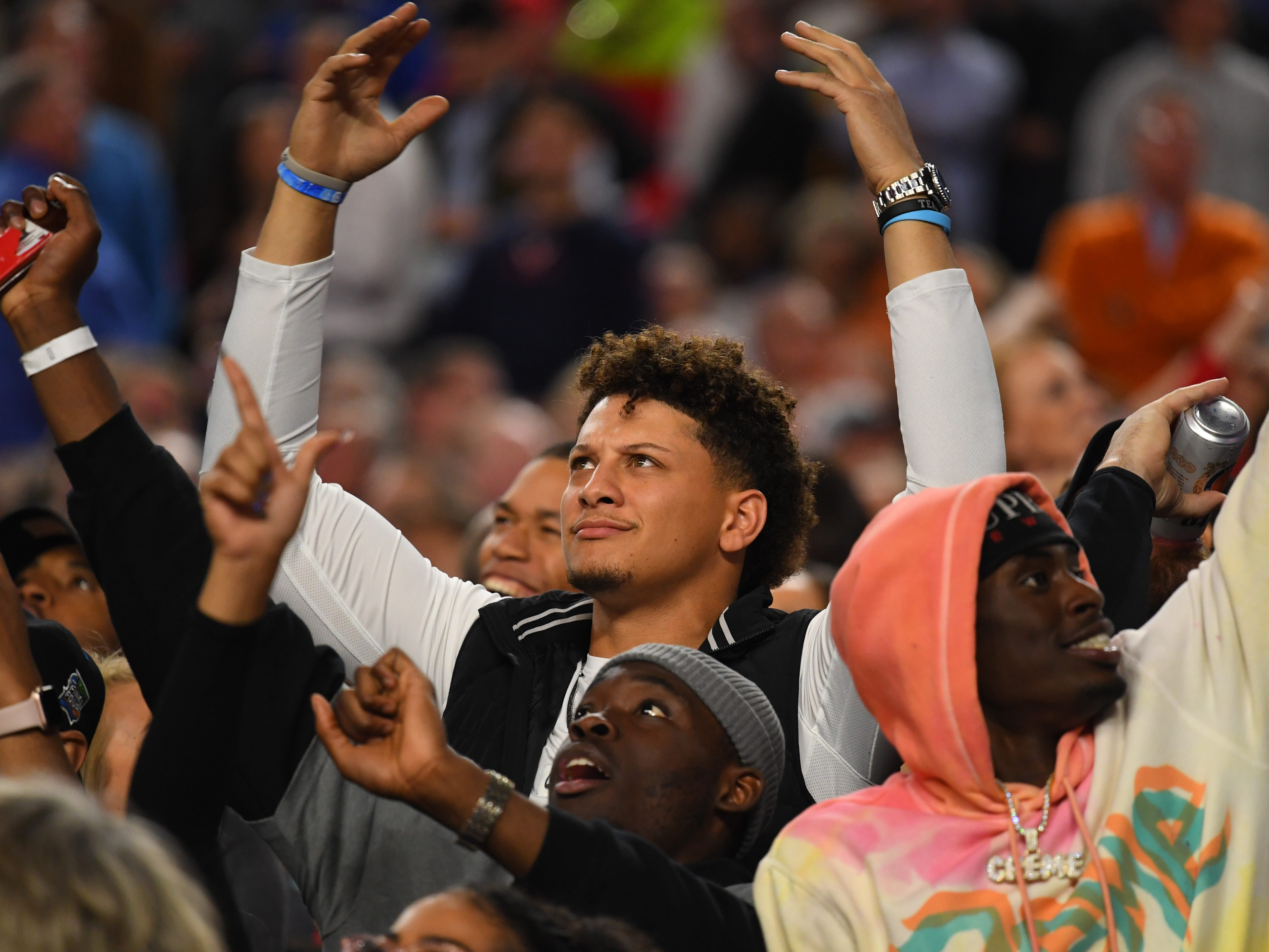 Kansas City Chiefs quarterback and former Texas Tech player Patrick Mahomes cheers in the stands.