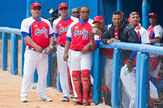 Players of the Cuban national team wait before an MLB exhibition game between the Tampa Bay Rays and the Cuban national team, at Latinoamericano stadium in Havana in 2016.