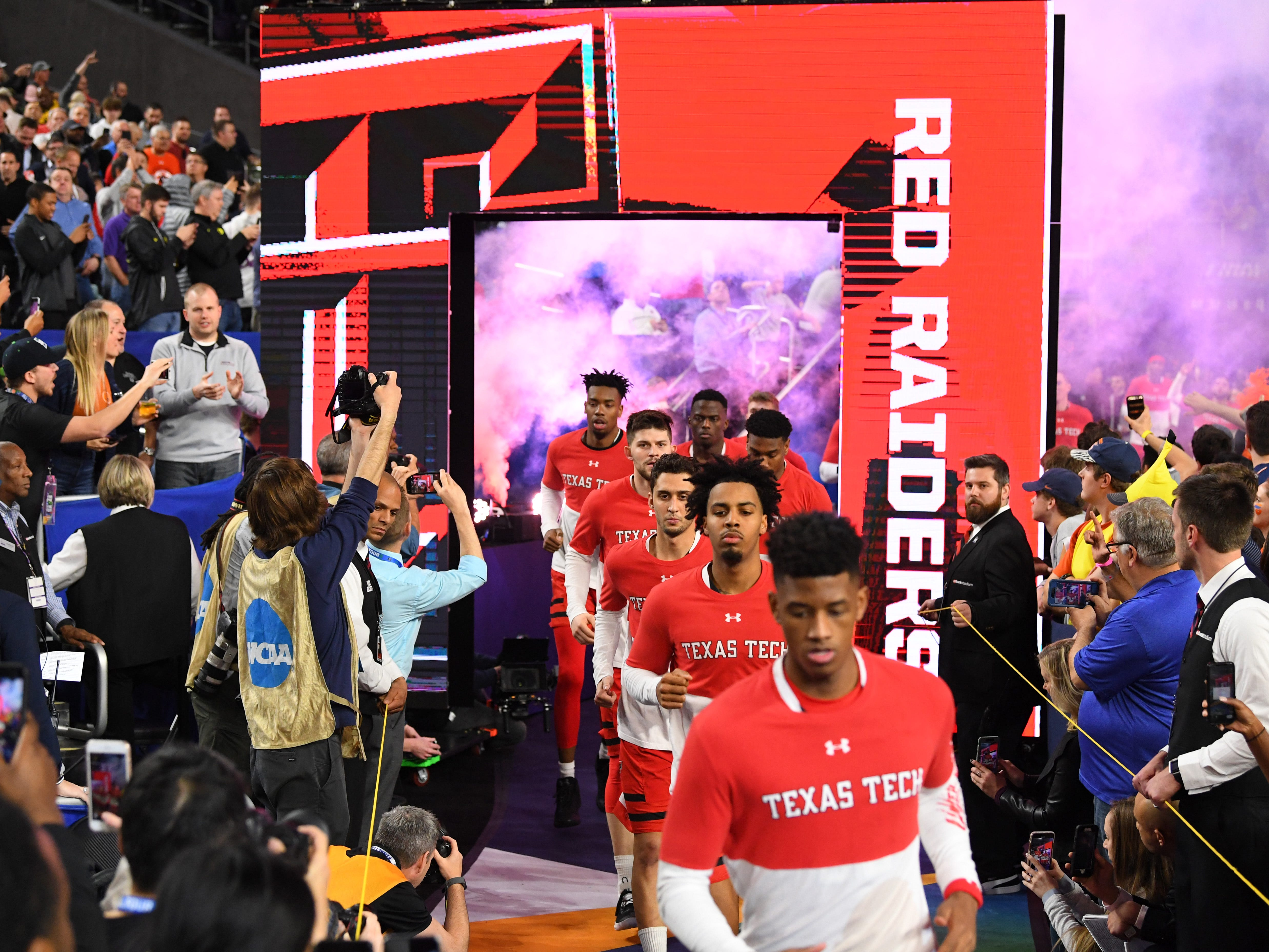 The Texas Tech Red Raiders take the floor prior to facing the Virginia Cavaliers in the championship game.