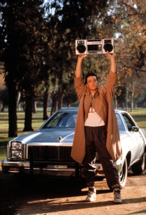 """John Cusack's Lloyd Dobler raises his boom box high and blasts Peter Gabriel's """"In Your Eyes"""" to win back his girlfriend in the 1989 film """"Say Anything."""""""