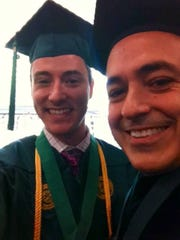 Zach Eisenstein and George Mason University President Ángel Cabrera