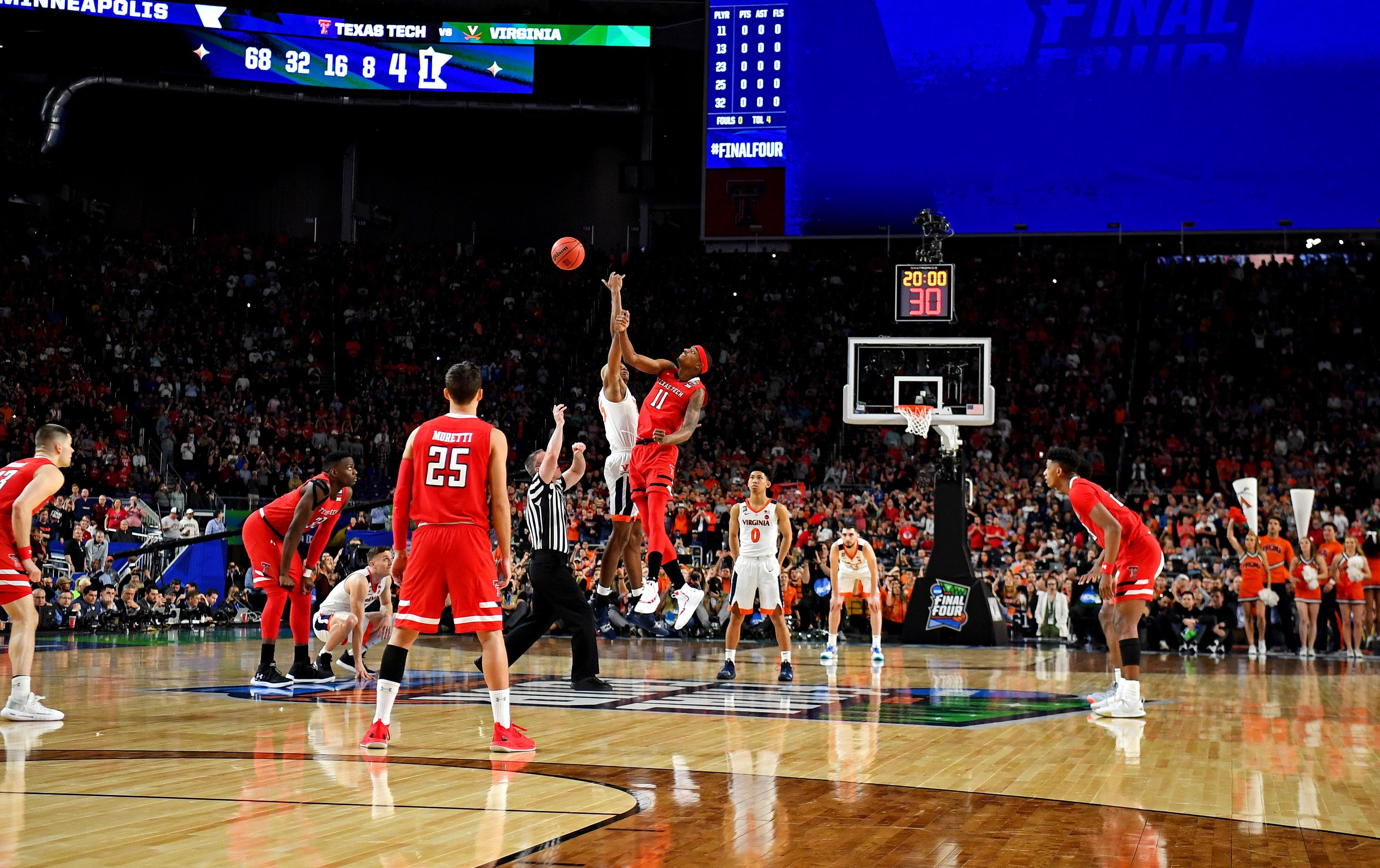 Texas Tech forward Tariq Owens (11) and Virginia forward Mamadi Diakite go for the opening tip in the championship game of the 2019 NCAA tournament.