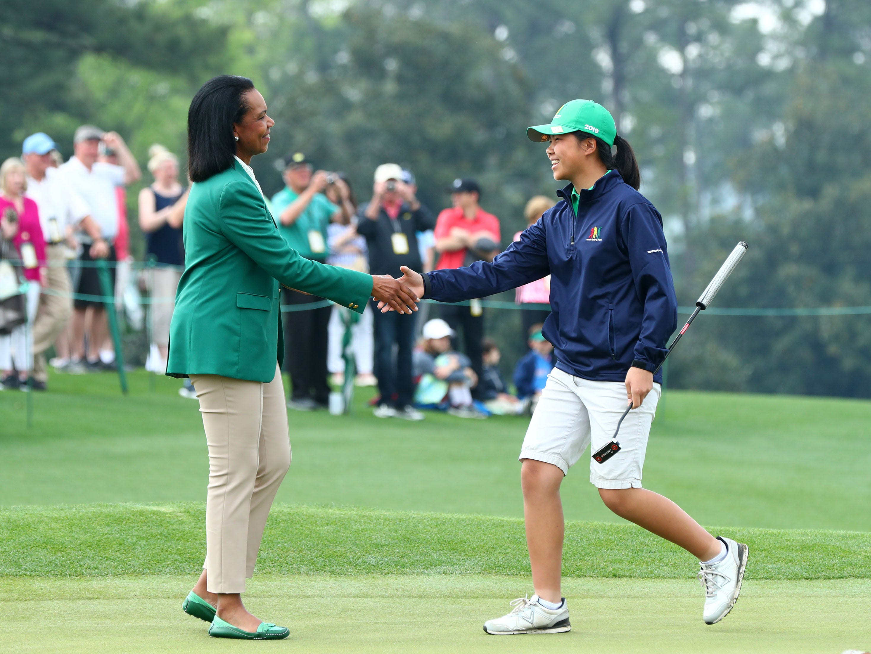 Augusta National member and former Secretary of State Condoleezza Rice congratulates overall champion Sophia Li of Fresh Meadows, N.Y. for the girls 10-11 age group during the finals of the Drive, Chip and Putt competition at Augusta National Golf Club.