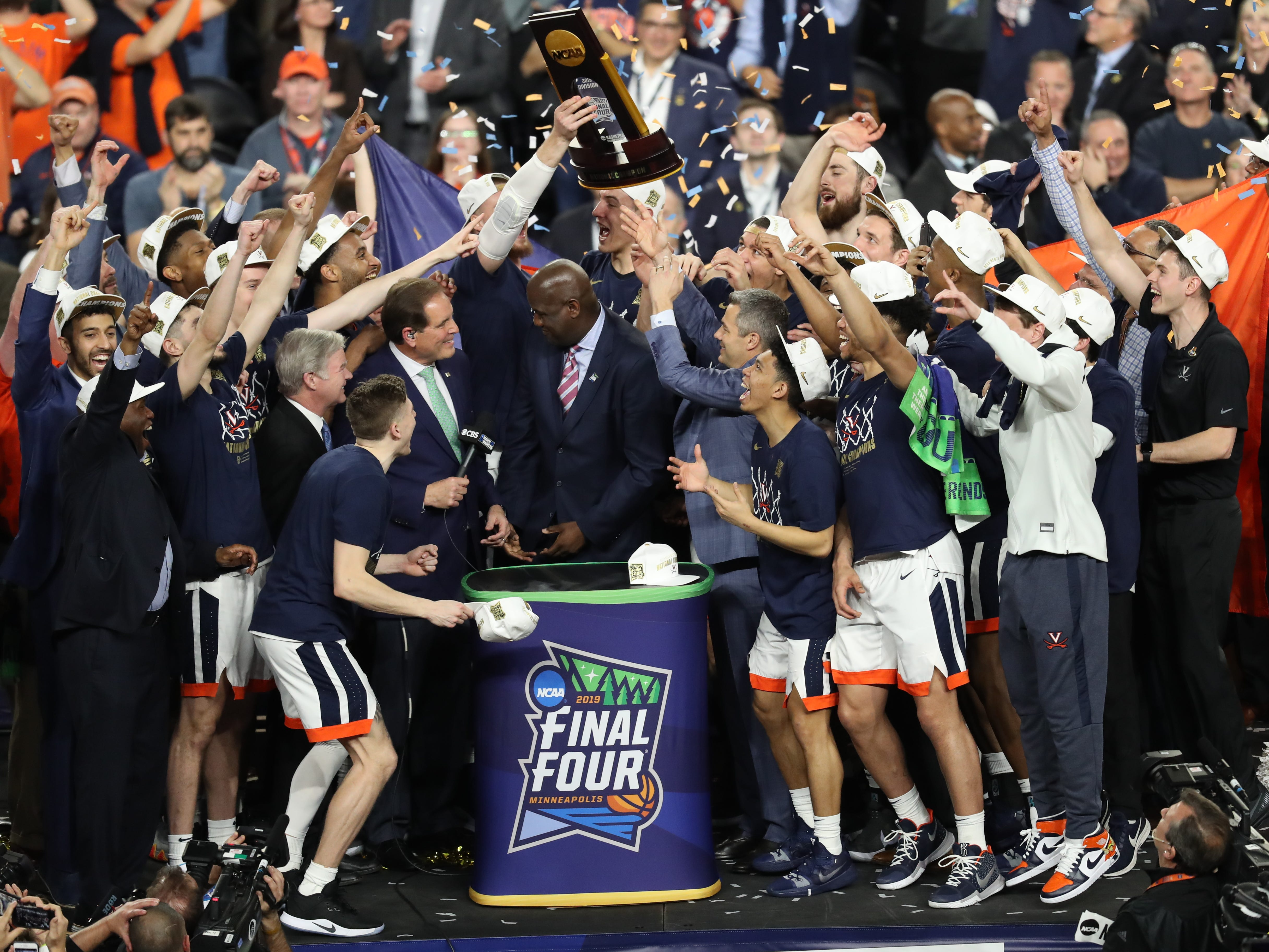 Virginia coach Tony Bennett is presented with the national championship trophy after defeating Texas Tech in the championship game.