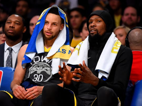 The season is just getting started for the Warriors, Stephen Curry (left) and Kevin Durant.