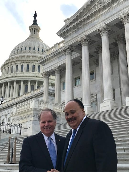 Sen. Doug Jones and Martin Luther King III chat outside the U.S. Capitol April 9, 2019.