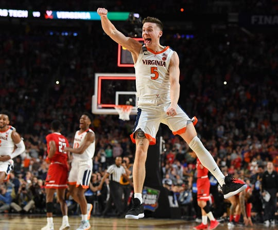 Virginia guard Kyle Guy celebrates after the Cavaliers defeated Texas Tech to win the national championship in the 2019 NCAA tournament.
