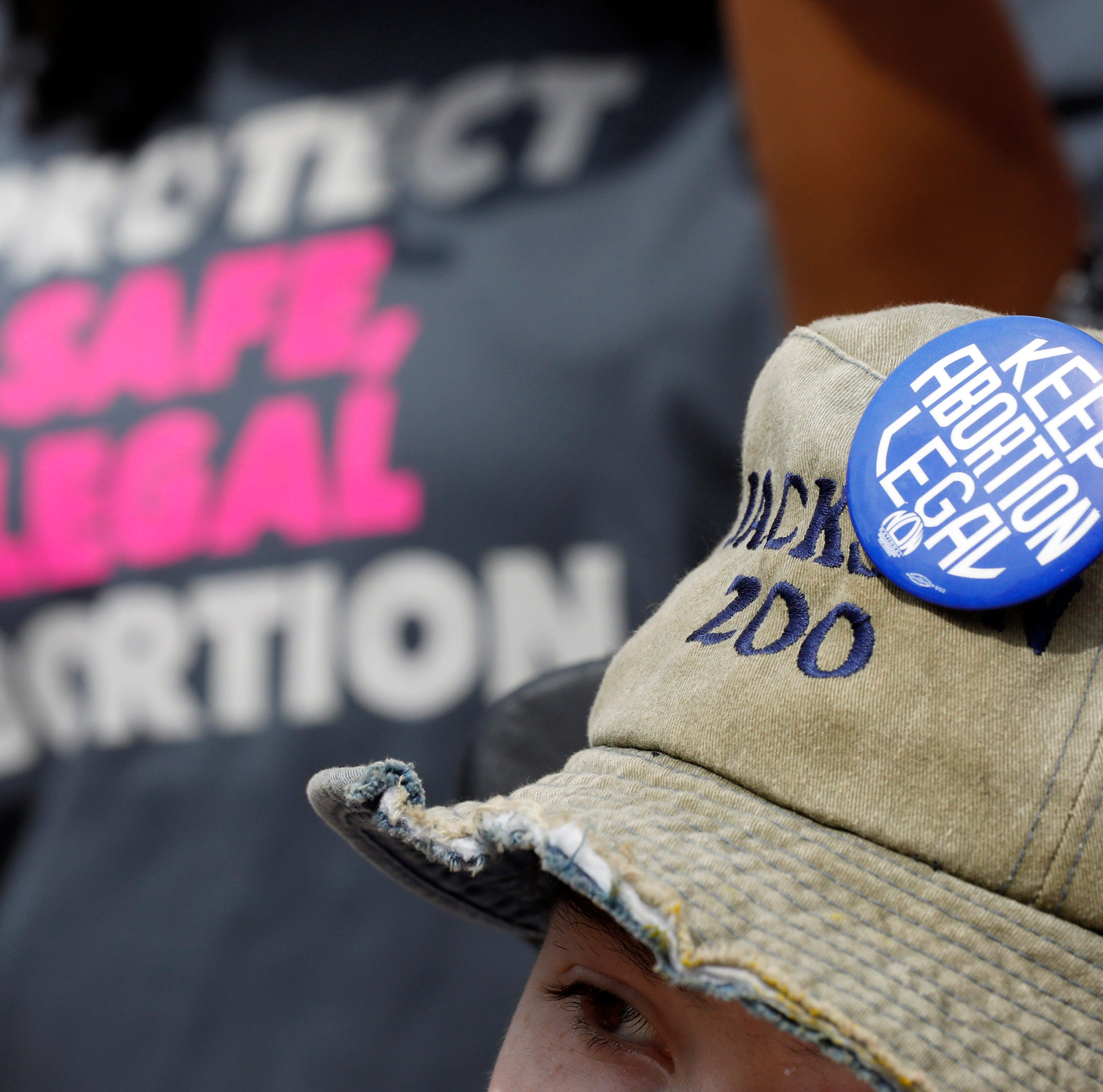 In this March 14, 2019 file photograph, a Planned Parenthood supporter hosts an abortion rights button on her hat during a rally on the steps of the Capitol in Jackson, Mississippi.