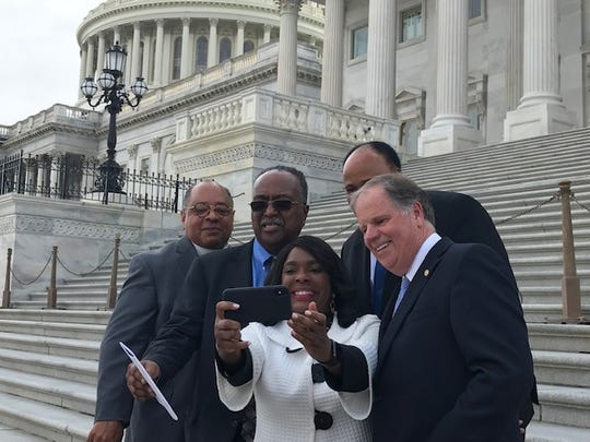 Rep. Terri Sewell, D-Ala., takes a selfie with Rev. Canon Leonard L. Hamlin, Sr. of the National Washington Cathedral, Charles Steele, president of the Southern Christian Leadership Conference, Sen. Doug Jones, D-Ala., and Martin Luther King III, April 9, 2019.