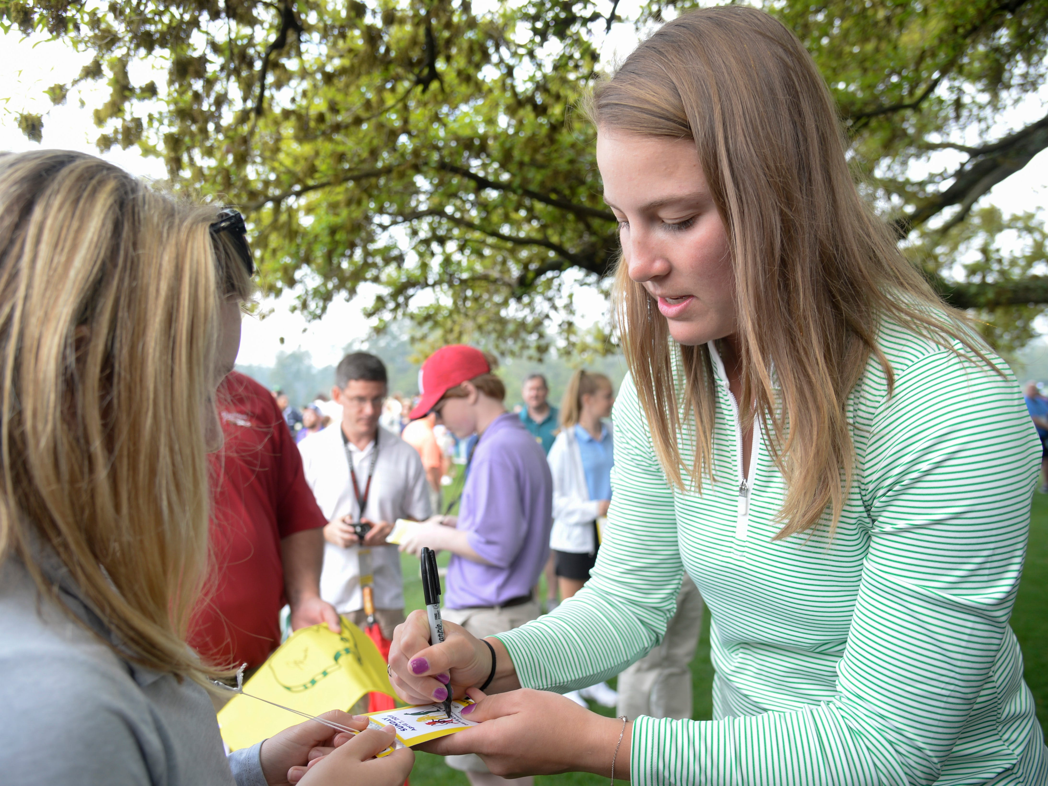 Augusta National Womens Amateur champion Jennifer Kupcho (right) signs autographs during the finals of the Drive, Chip and Putt competition at Augusta National Golf Club.