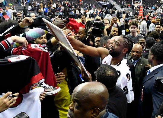 Dwyane Wade greets fans.