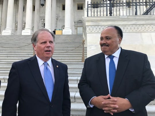 "Sen. Doug Jones, D-Ala., and Martin Luther King III talk to reporters April 9, 2019 after a bipartisan group of senators read Martin Luther King's ""Letter from Birmingham Jail'' on the Senate floor."