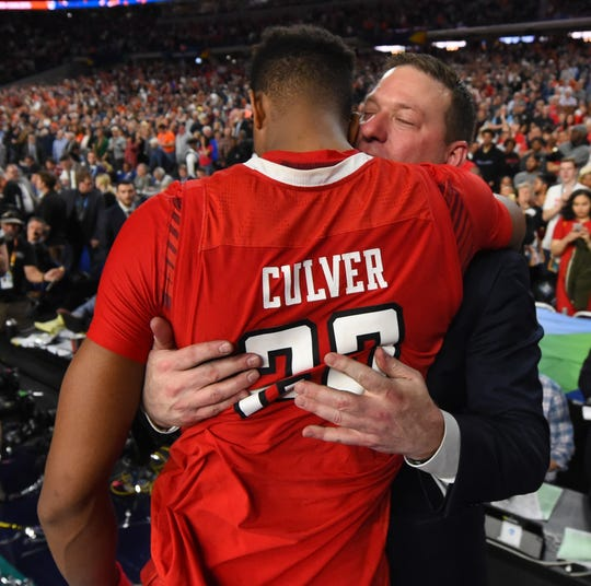 Texas Tech coach Chris Beard consoles guard Jarrett Culver after losing to Virginia in the championship game.