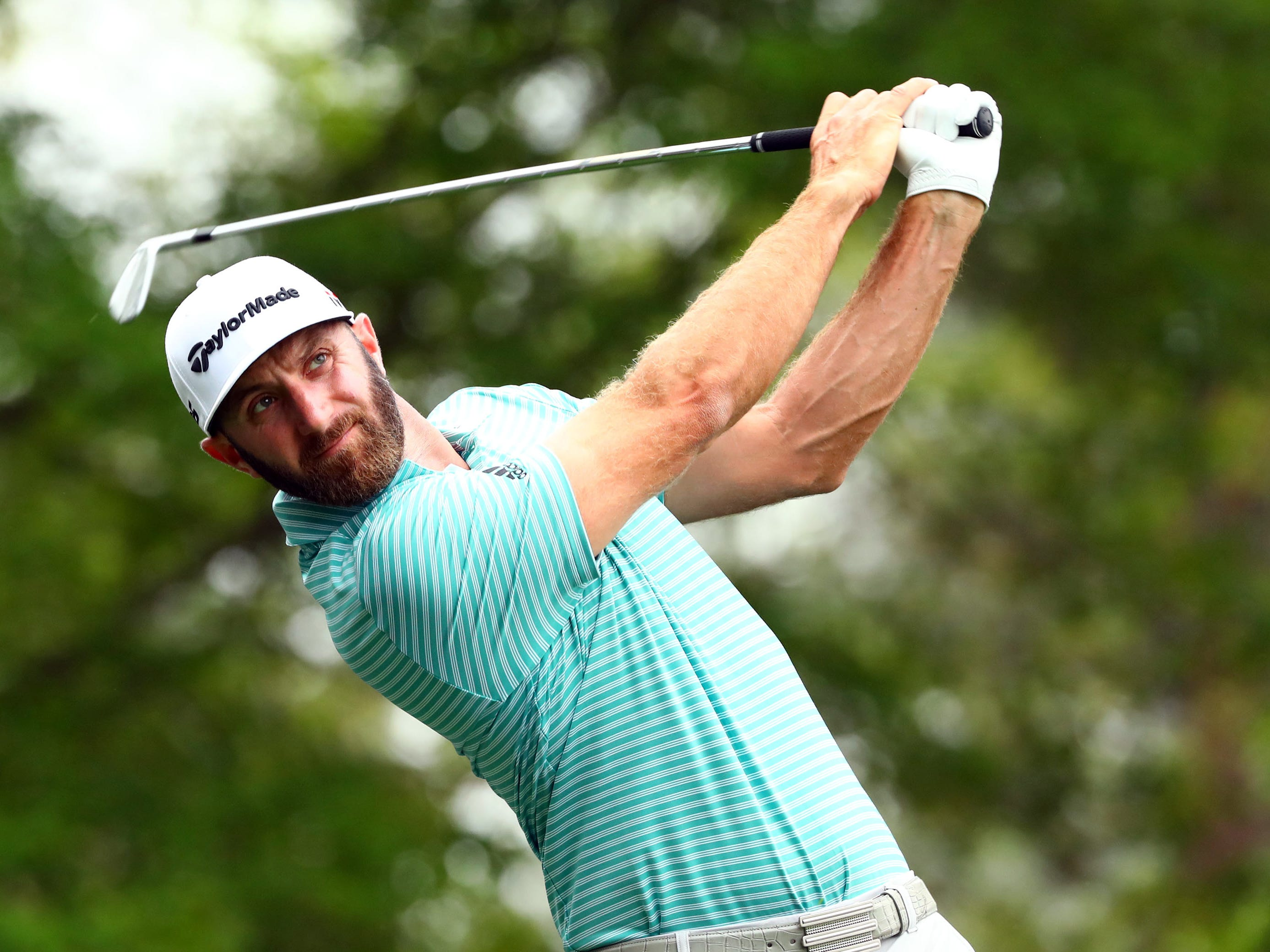 Dustin Johnson hits his tee shot on the fourth hole during a practice round for the Masters golf tournament at Augusta National Golf Club.