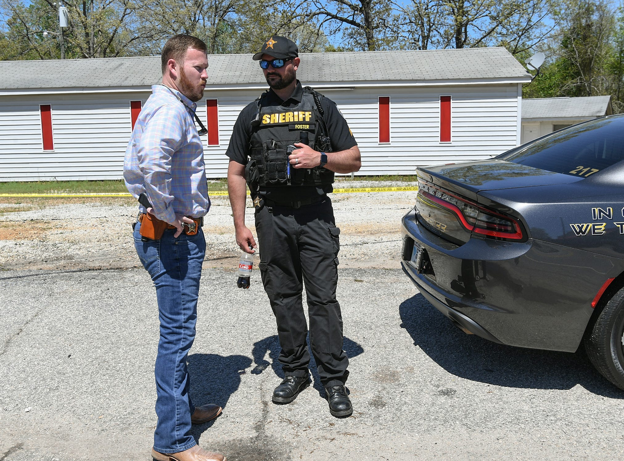 Anderson County Sheriff Chad McBride, left, and public information officer J.T. Foster at the scene of a shooting at Hilltop Motel on Hwy 29 where two people were reported shot and as many as seven were involved in a dispute Wednesday, April 10, 2019.