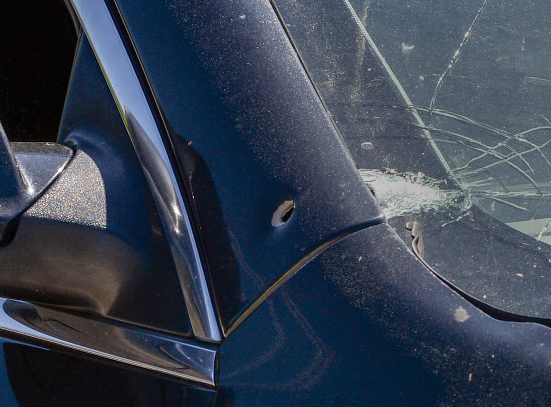 Anderson County Sheriff's Office deputies respond to a shooting at Hilltop Motel on Hwy 29 where two people were reported shot and as many as seven were involved in a dispute Wednesday, April 10, 2019. One of the two cars with bullet holes in it.