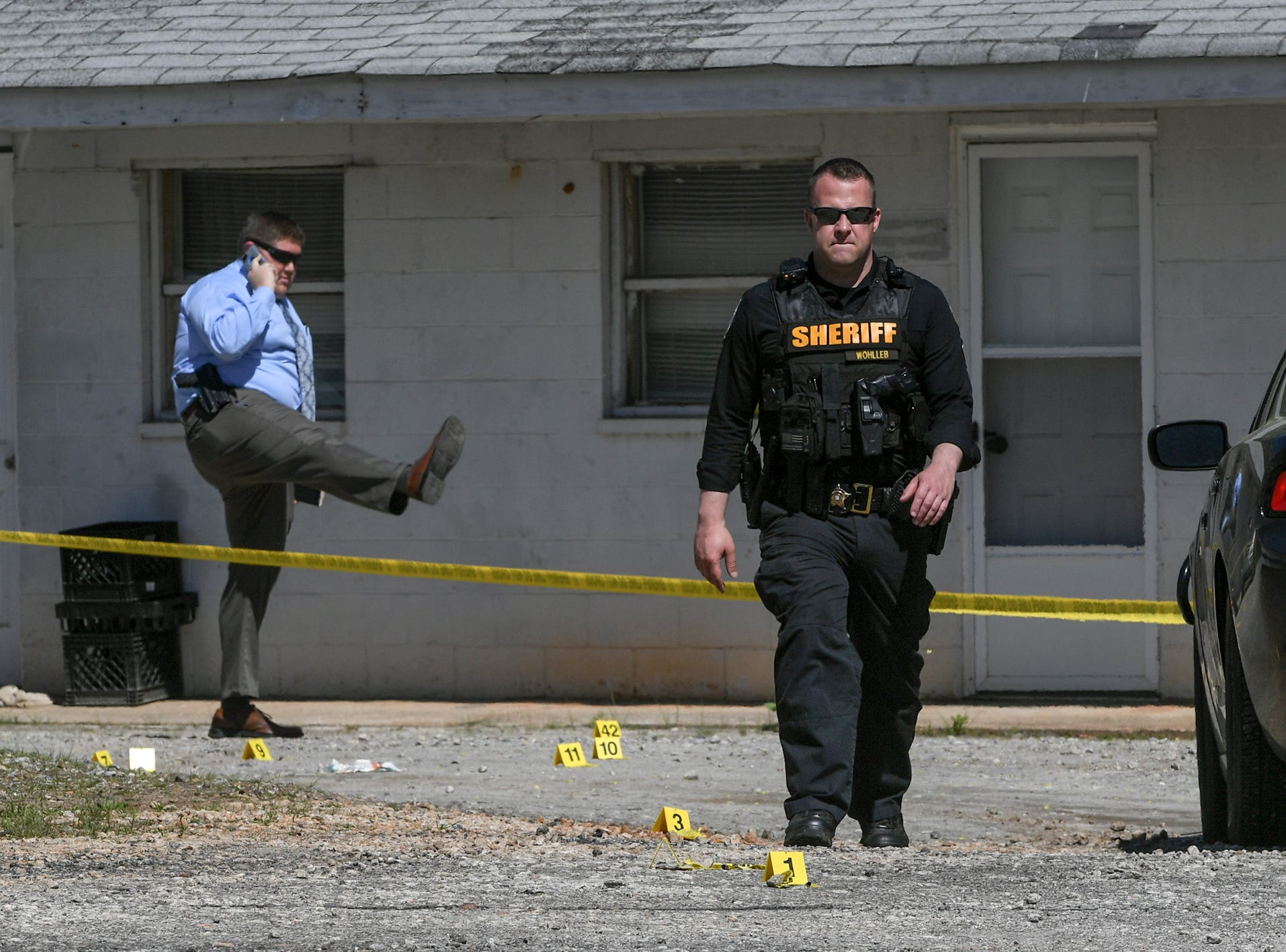 Anderson County Sheriff's Office investigators at Hilltop Motel on Hwy 29 where two people were reported shot and as many as seven were involved in a dispute Wednesday, April 10, 2019.