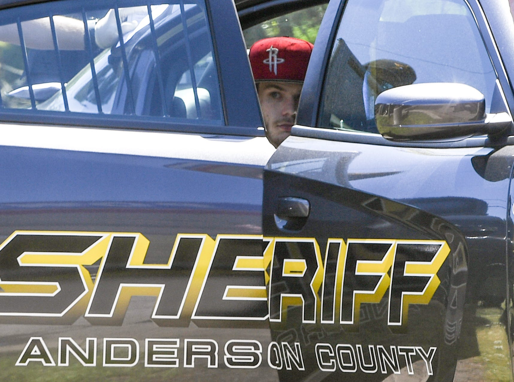 Anderson County Sheriff's Office deputies retain one of two men in handcuffs after responding to a shooting at Hilltop Motel on Hwy 29 Wednesday, April 10, 2019.