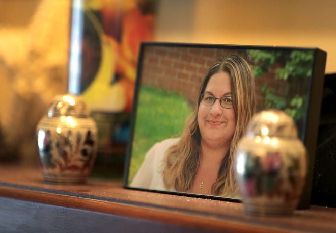 A framed photo of Laurie Colon sits on a shelf in her mother's home in Appleton. Laurie Colon was shot and killed by her husband, Greg Colon, in July.