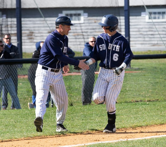 Middletown South's Trevor Brey shakes hands with coach Ryan Spillane after his two-run home run Wednesday in Middletown South's 8-2 win at Christian Brothers Academy.