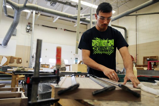 Josh Martinez, 18, of Cream Ridge makes side tables during woodworking class at Ocean County Vocational Technical School in Jackson, NJ Thursday, April 4, 2019.
