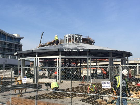 Workers construct the pavilion that will house the carousel at Pier Village in Long Branch on April 5, 2019.