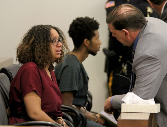 Jada M. McClain and Quaimere Mohammed speak with their attorneys before a conference in Judge David Bauman's courtroom in State Superior Court in Freehold Wednesday, April 10, 2019.  McClain is charged with the murder of her newborn baby and the baby's father Mohammed is charged with desecrating the infant's remains.
