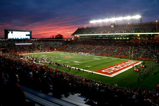 Light from the sunset is seen during the first half of an NCAA college football game between Rutgers and Michigan State, Saturday, Nov. 25, 2017, in Piscataway, N.J. (AP Photo/Julio Cortez)