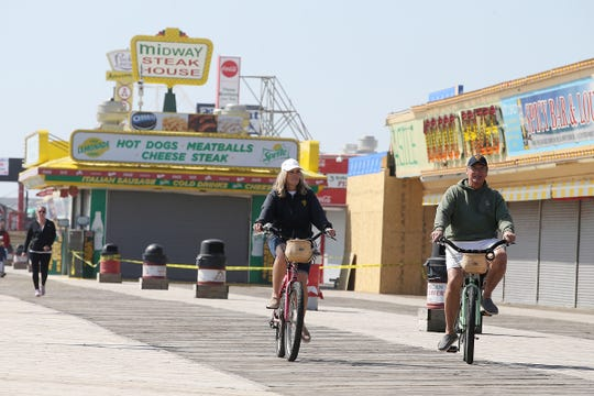 Kim and Ray Toscano of Lavallette ride their bikes along the boardwalk with their grandson, Kellan Magliara of Point Pleasant Boro, in Seaside Heights, NJ Monday April 8, 2019.