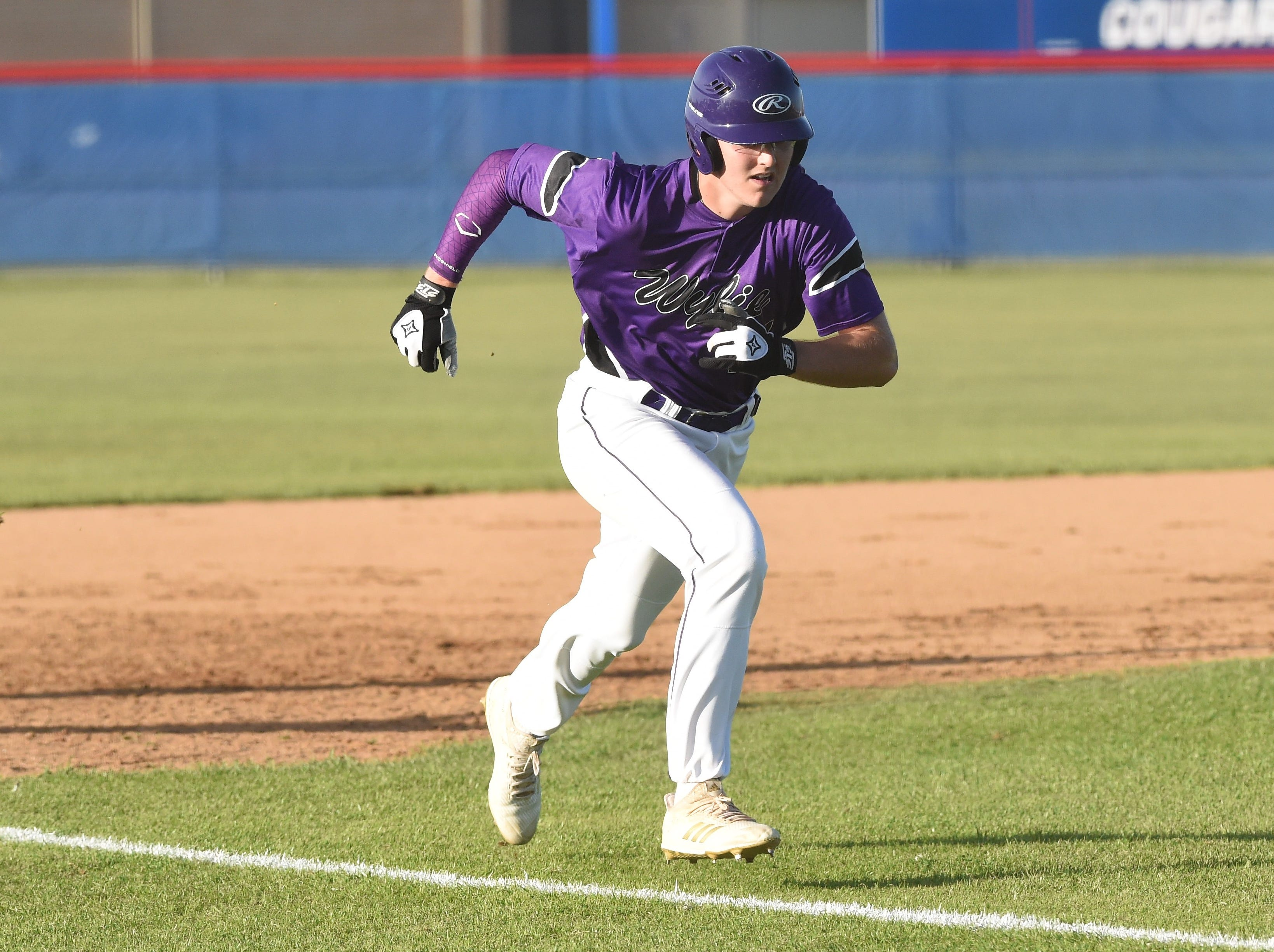 Wylie's Kanon Doby (17) runs down the third-base line to score against Cooper at Cougar Field on Tuesday, April 9, 2019. Doby had two hits, an RBI and scored in the Bulldogs 11-5 win.