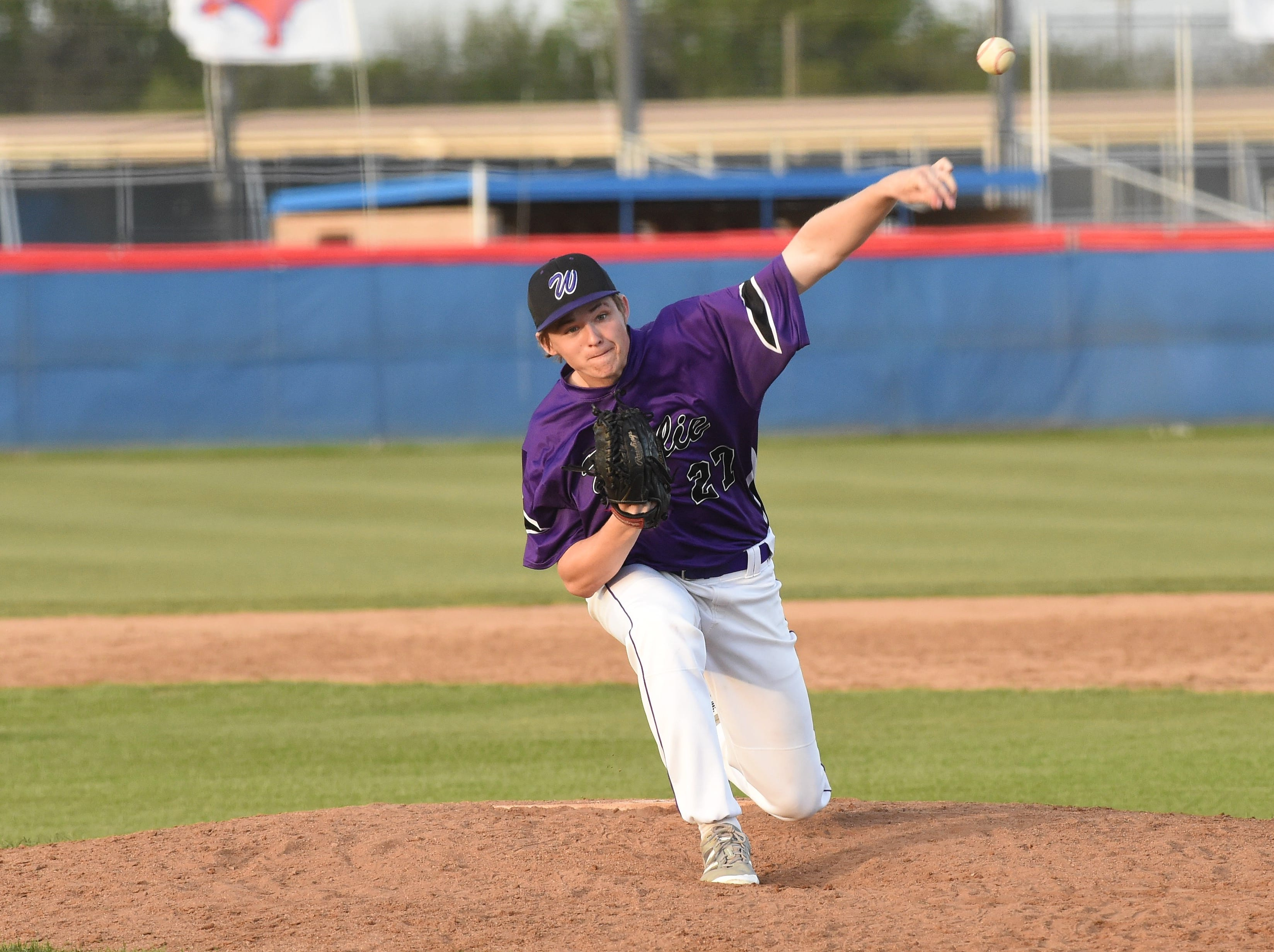 Wylie's Reed Hughes (27) lets go of a pitch against Cooper at Cougar Field on Tuesday, April 9, 2019. Hughes got the final out, a strikeout, in the Bulldogs 11-5 win.