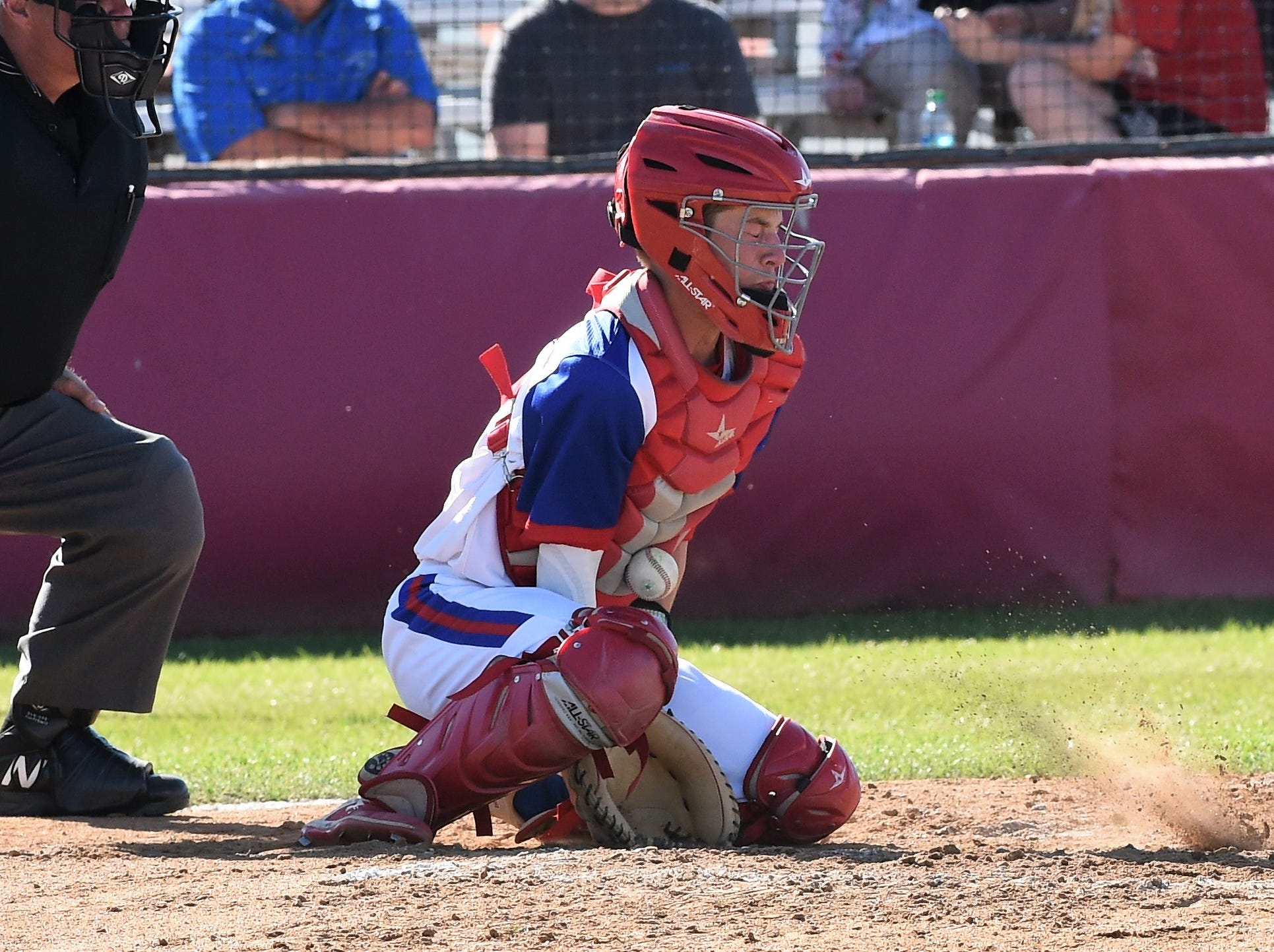 Cooper catcher Jacob Hummel (11) blocks a pitch in the dirt against Wylie at Cougar Field on Tuesday, April 9, 2019. Hummel had a hit, an RBI and walked twice as the Cougars fell 11-5.