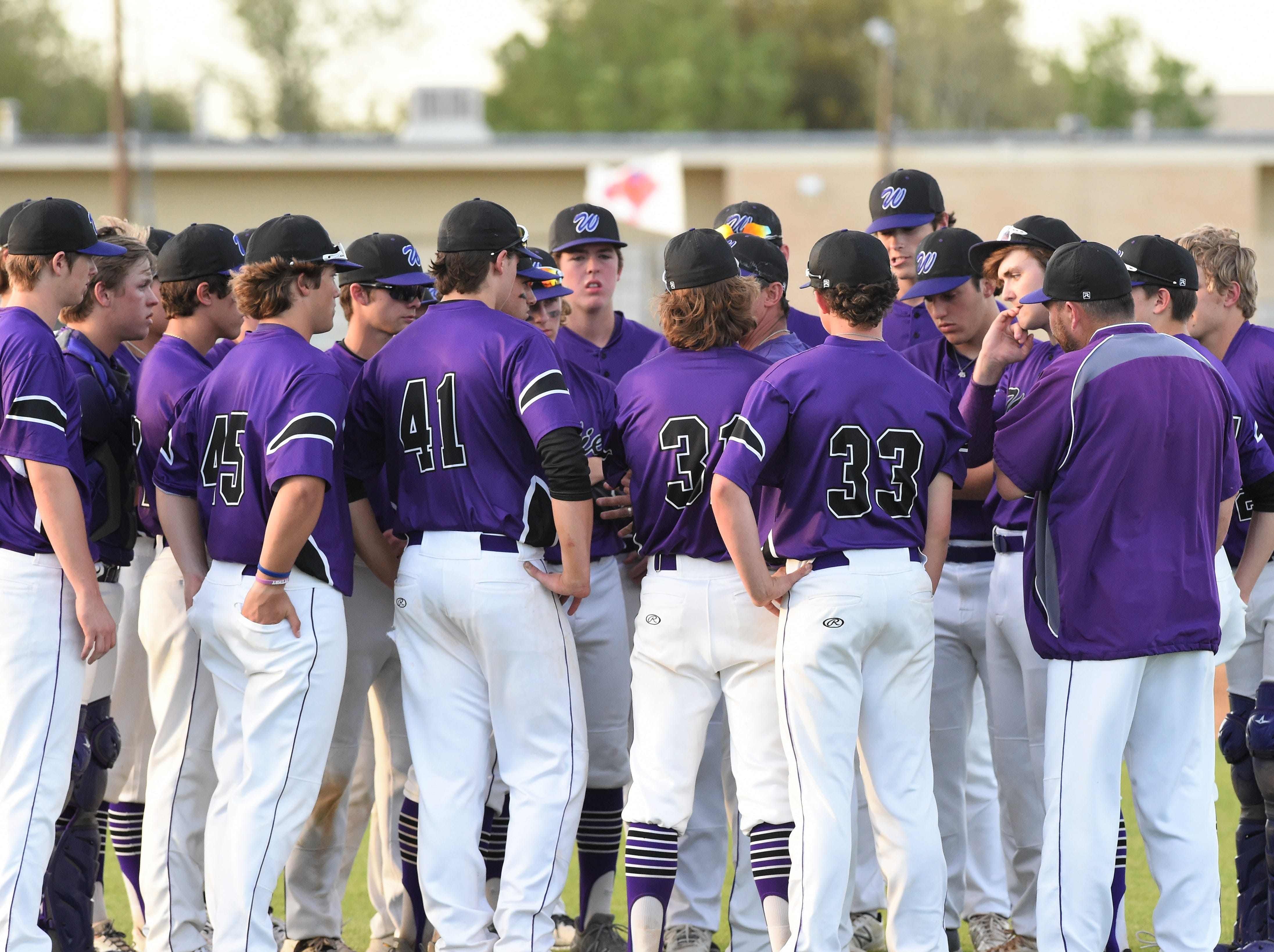 Wylie coach Clay Martin talks to the Bulldogs after defeating Cooper 11-5 at Cougar Field on Tuesday, April 9, 2019.