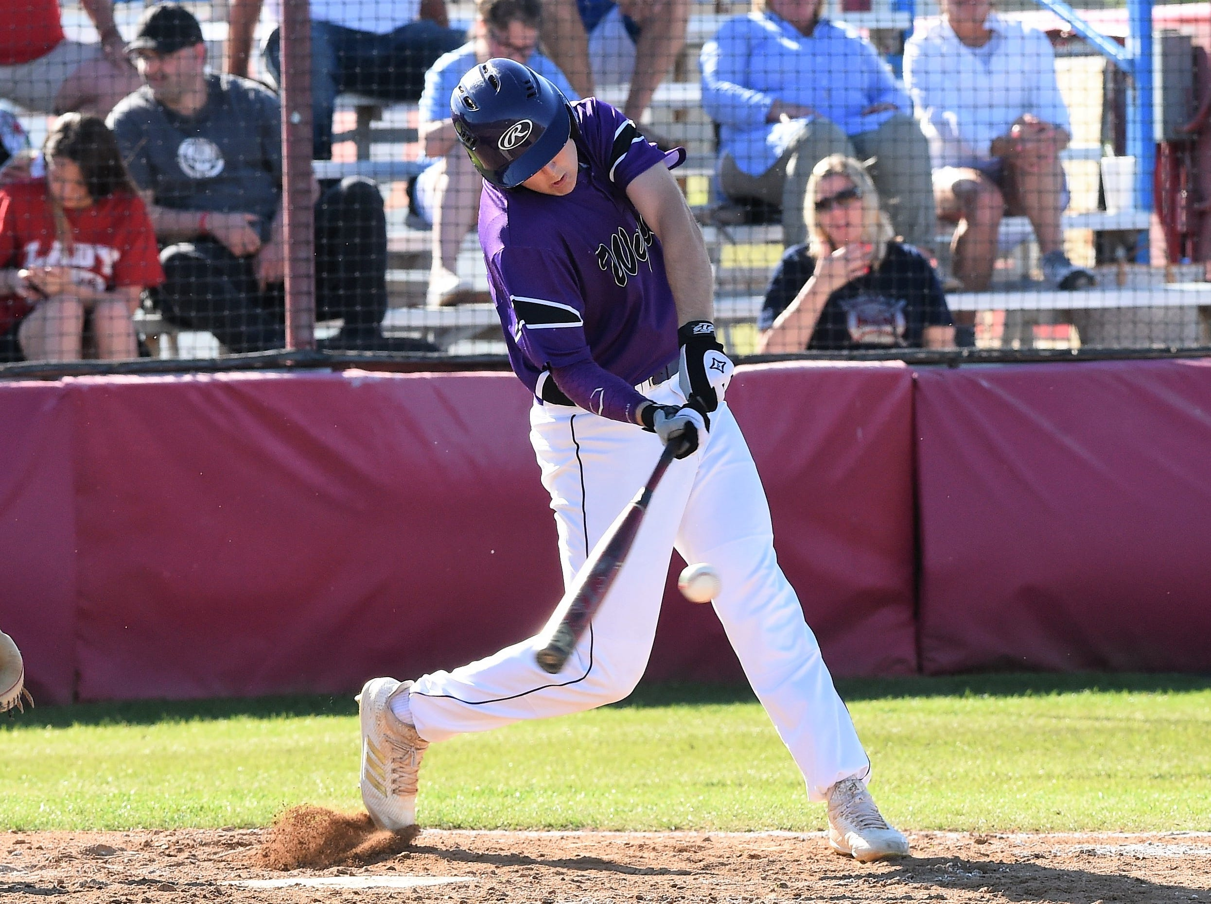 Wylie's Kanon Doby (17) turns on a pitch against Cooper at Cougar Field on Tuesday, April 9, 2019. Doby had two hits, including a double, scored and drove in a run as the Bulldogs won 11-5.