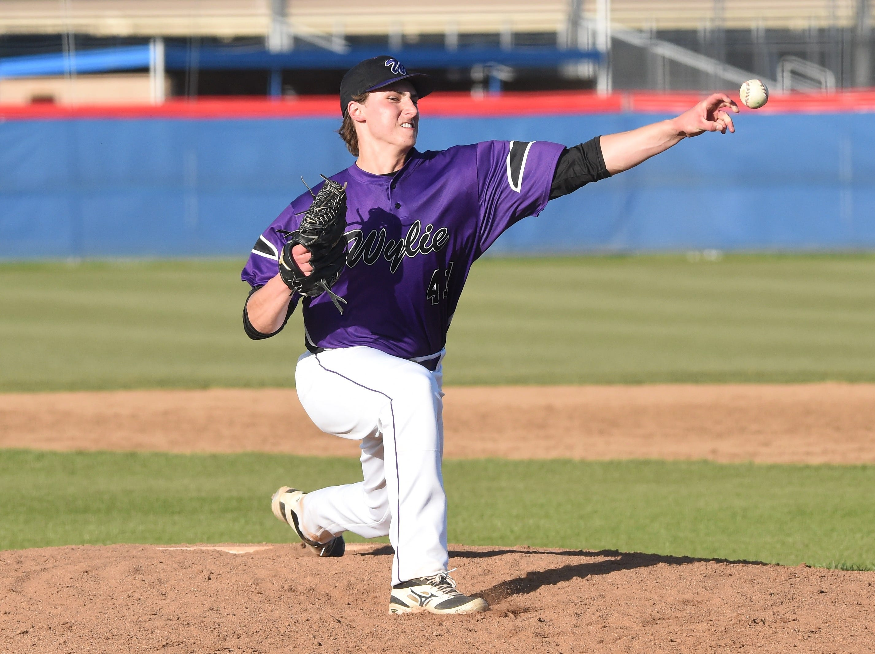 Wylie reliever Tyler Martin (41) lets go of a pitch against Cooper at Cougar Field on Tuesday, April 9, 2019. Martin worked three innings of relief in the Bulldogs 11-5 win.