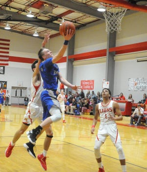 Stamford senior guard Trace Edwards goes for a layup against Albany in a District 8-2A boys basketball game at Albany High School