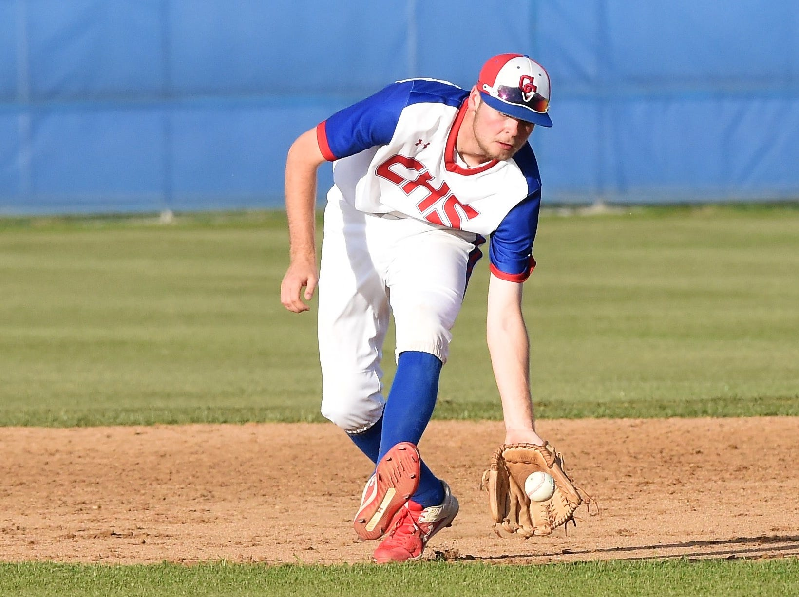 Cooper second baseman J.D. Creel (22) fields a grounder against Wylie at Cougar Field on Tuesday, April 9, 2019. The Cougars fell 11-5.