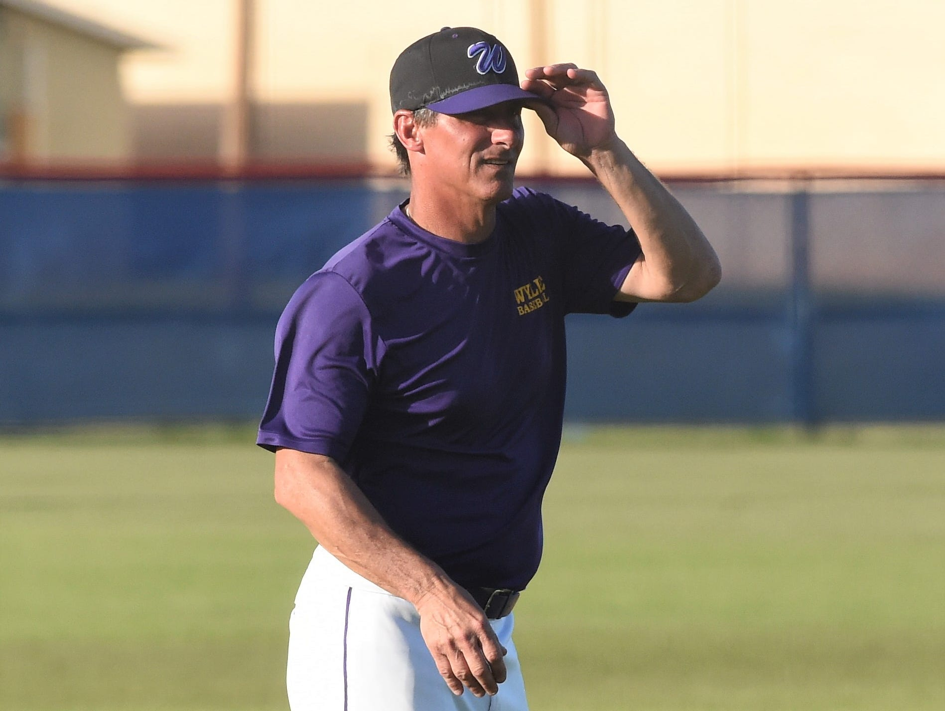 Wylie coach Clay Martin gives signs from third base against Cooper at Cougar Field on Tuesday, April 9, 2019. The Bulldogs won 11-5 and will go for the District 4-5A sweep on Friday at home.