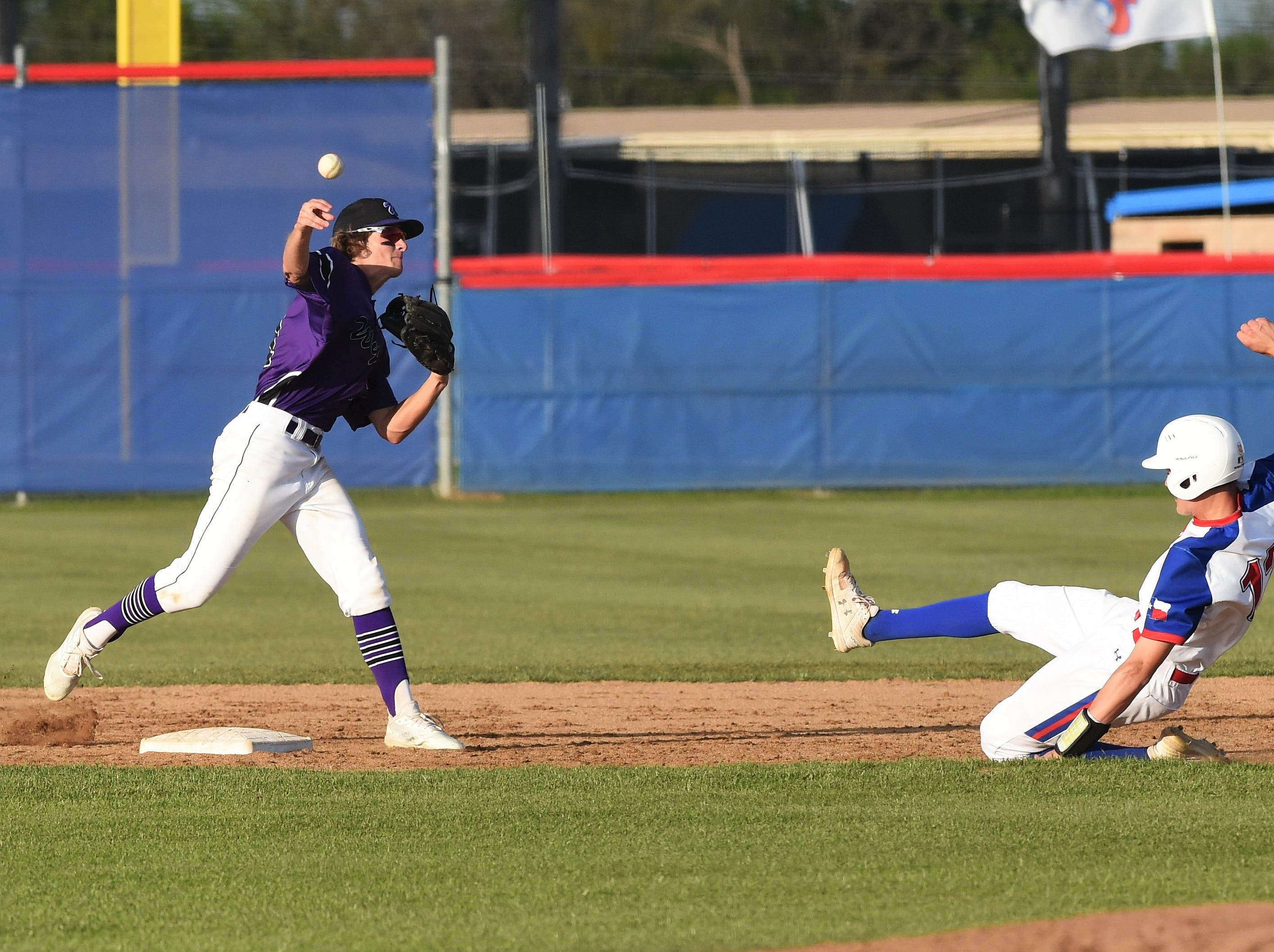Wylie second baseman Tyler Martin (31) throws to first to complete one of three double plays against Cooper at Cougar Field on Tuesday, April 9, 2019. Martin had two hits, two runs and an RBI in the 11-5 win.