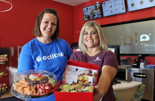 Kimberly Lindsay, left, and Carrie Smith are sisters-in-law who, with owner Diane Smith, operate Edible Arrangements, which will offer its fruit-based treats for the first time at next week's Taste of Abilene event.