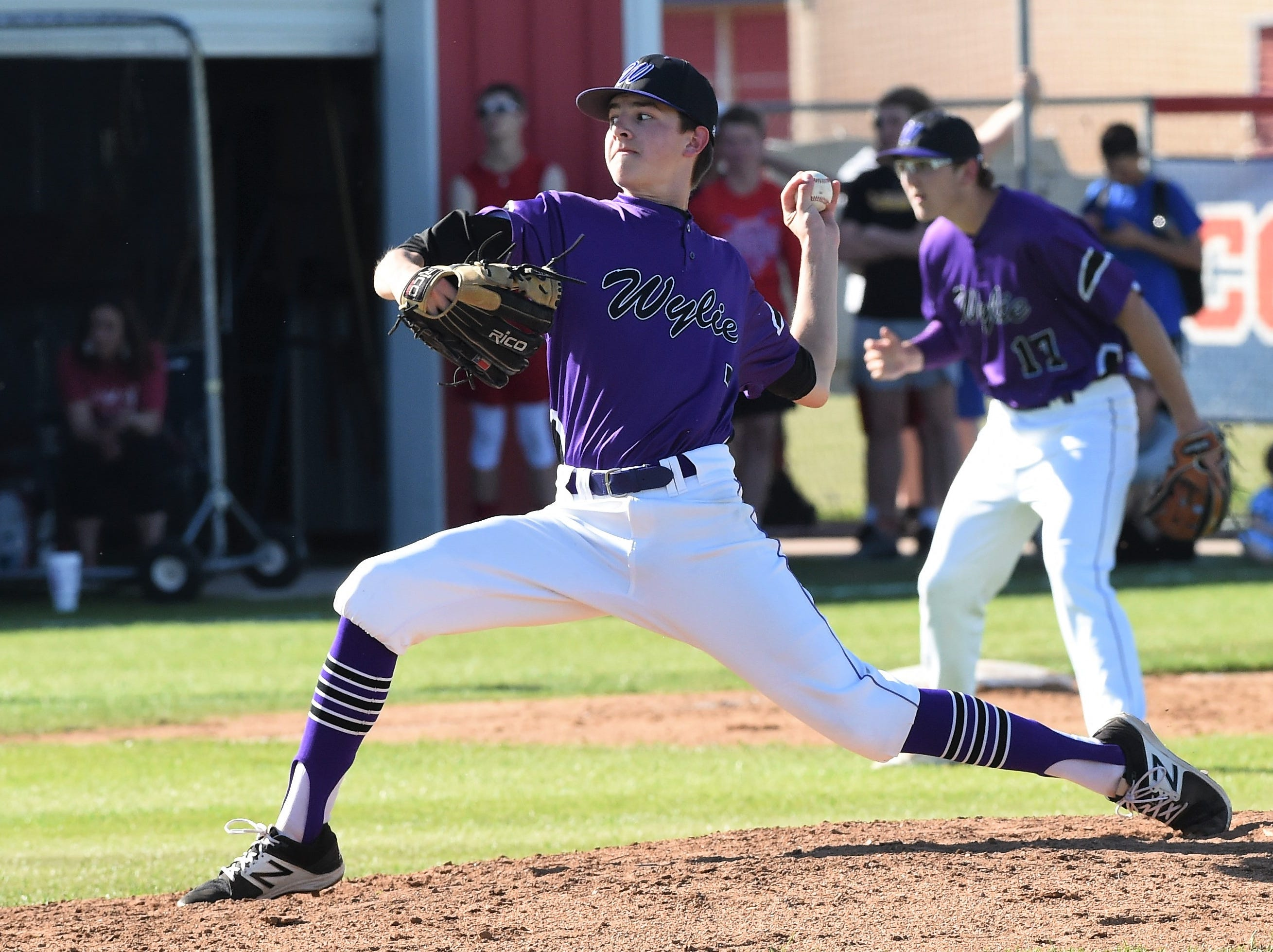 Wylie pitcher Dash Albus (7) delivers to the plate against Cooper at Cougar Field on Tuesday, April 9, 2019. Albus gave up one earned run on two hits with three strikeouts in over three innings of work as the Bulldogs won 11-5.