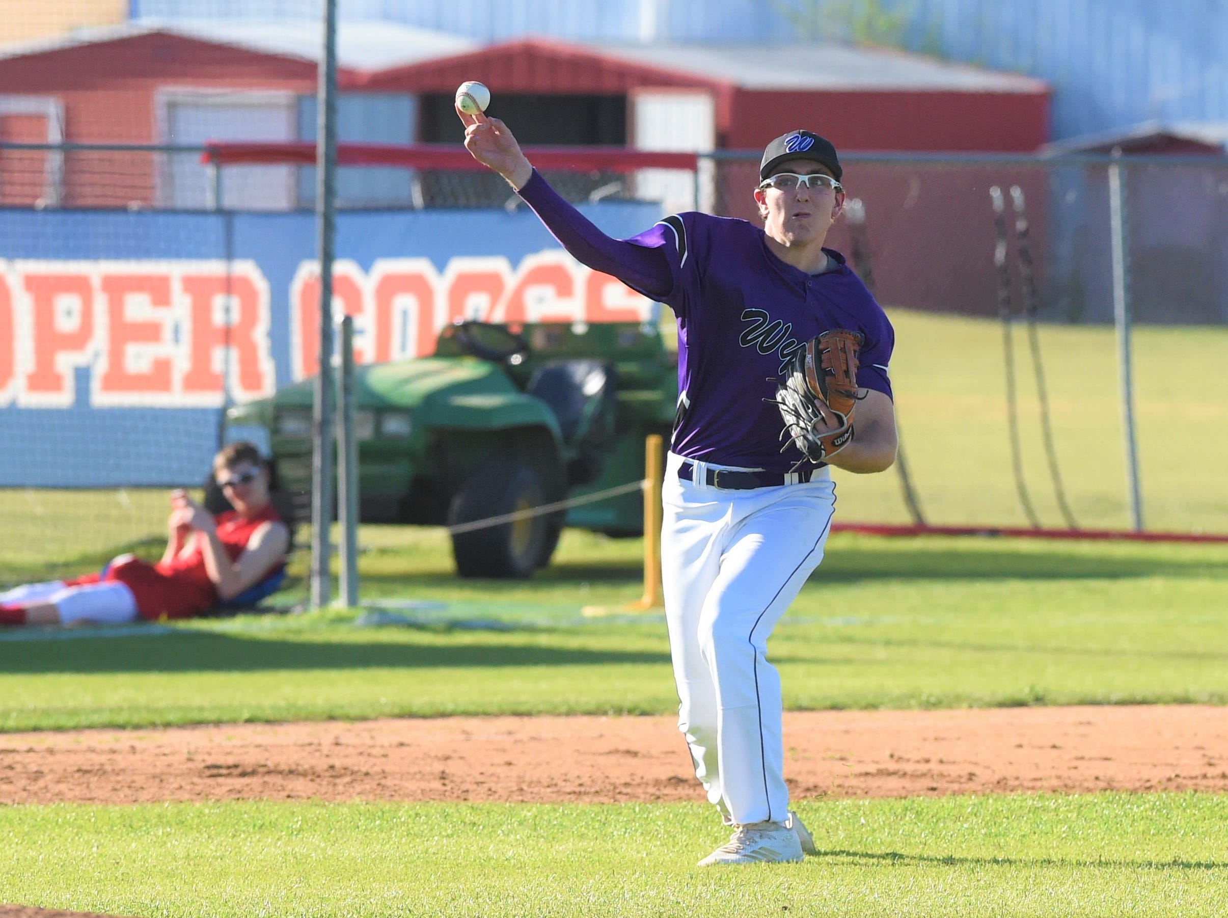 Wylie third baseman Kanon Doby (17) throws to first for an out against Cooper at Cougar Field on Tuesday, April 9, 2019. Doby had two hits, scored a run and drove in a run in the Bulldogs 11-5 win.