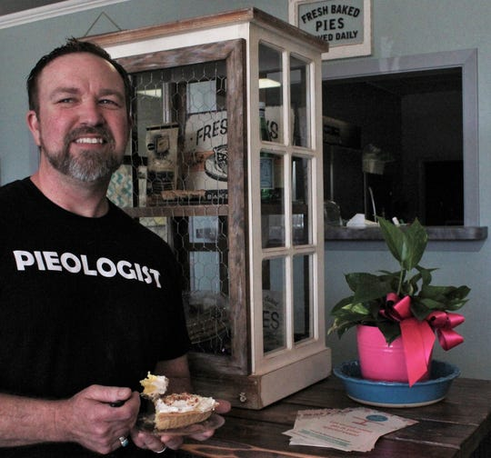 "Cory Bivens, who operates Life of Pie with his wife, Leslie, took a break from making pies Wednesday afternoon to sample coconut cream. Baking was to start Thursday evening for the first batch of chocolate pies for the Friday showing of ""The Help."""